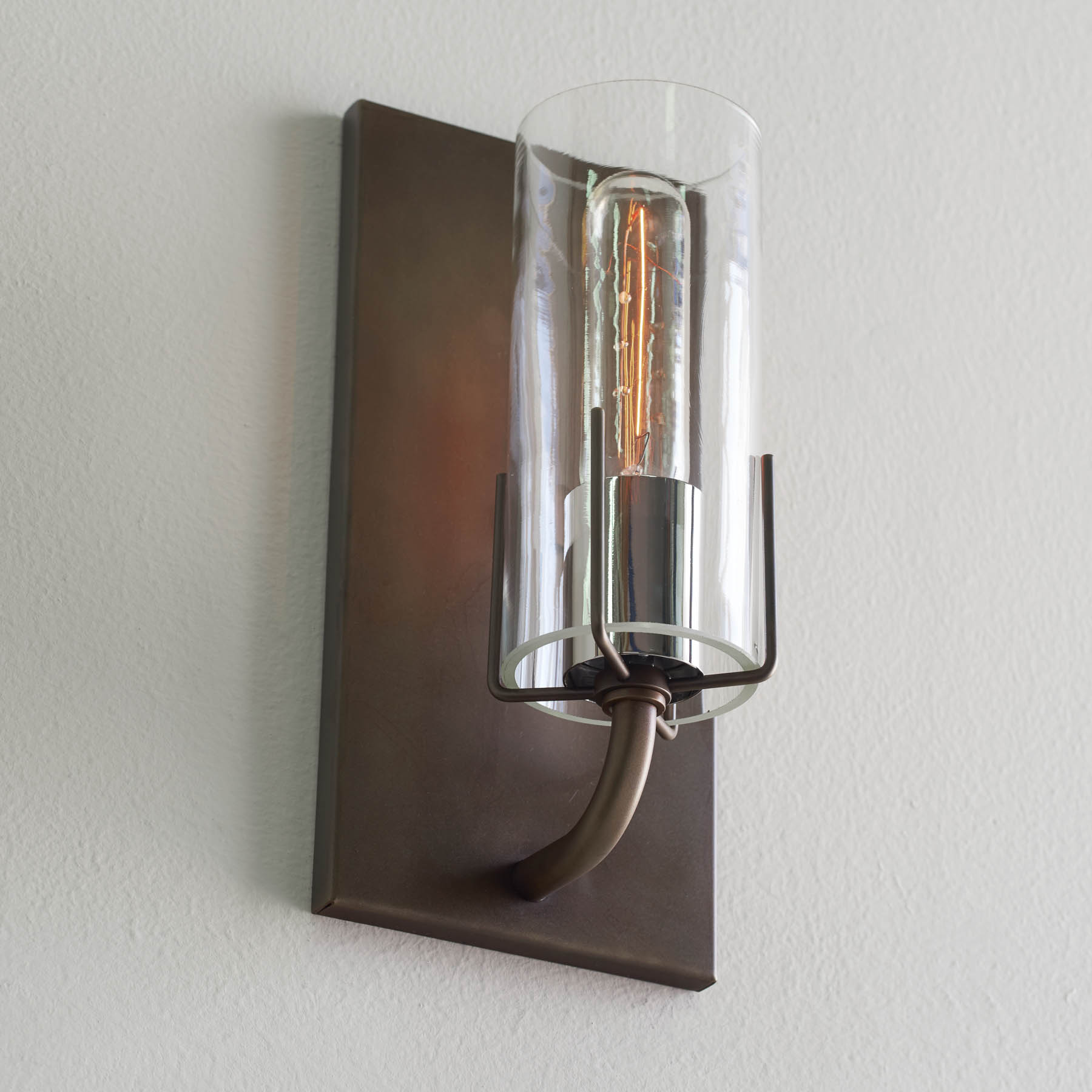 Dewberry Sconce, brass finish, nickel sleeve, and clear glass, wall sconces