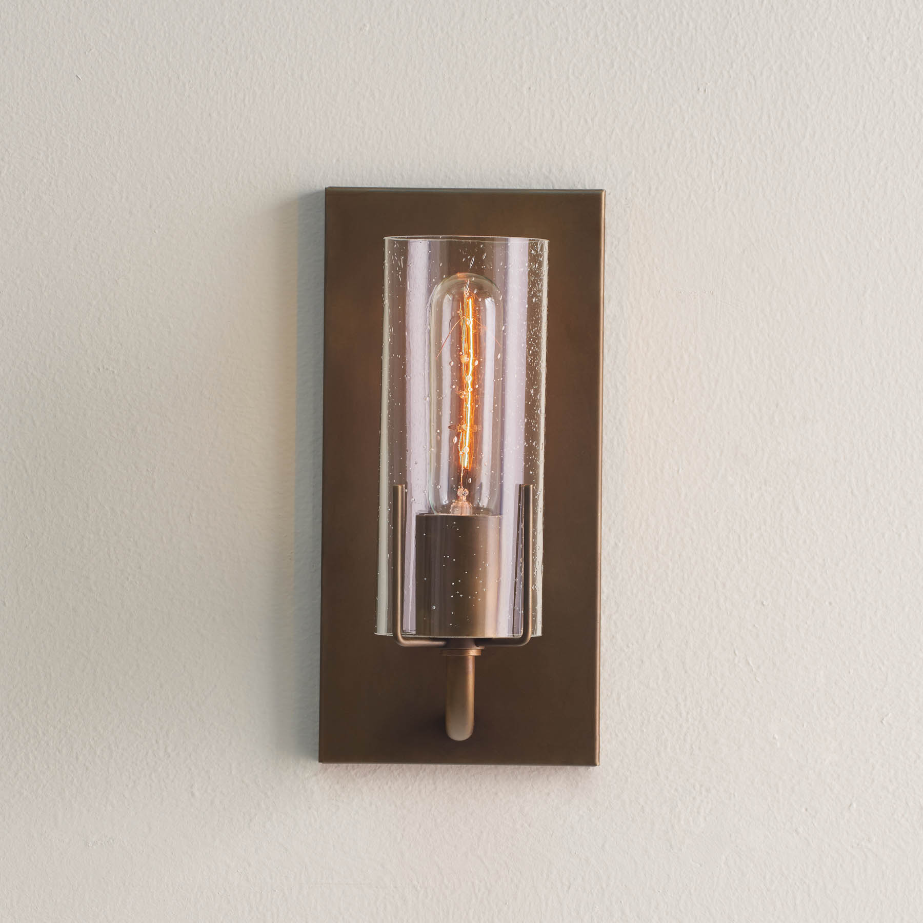 Dewberry Sconce, brass finish and sleeve with seeded glass