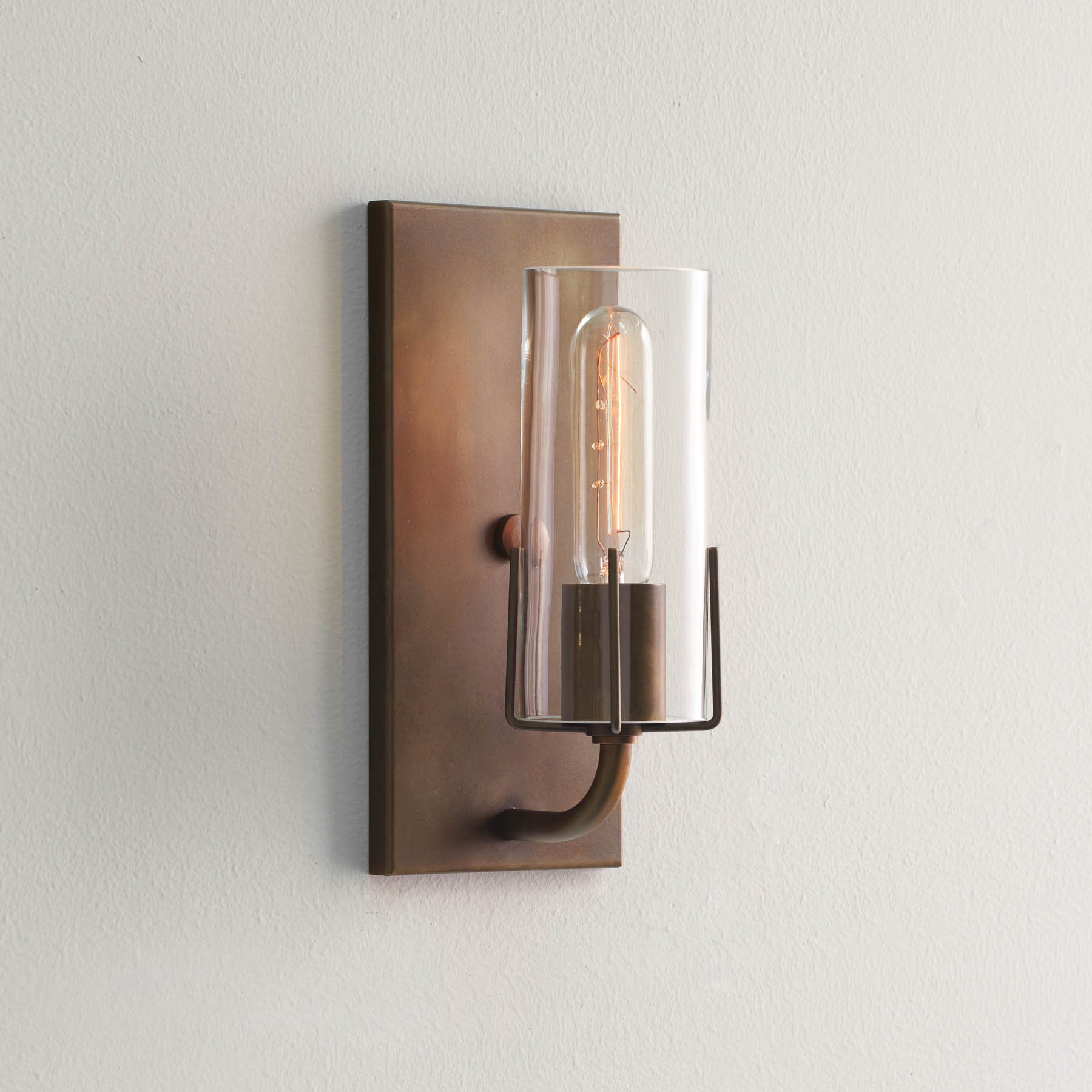 Dewberry Sconce, brass finish and sleeve with clear glass, side view, wall sconces